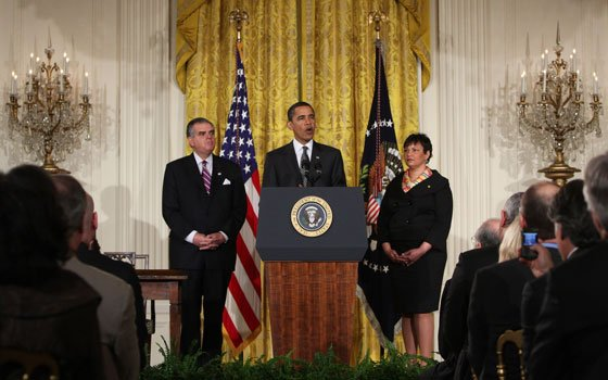 President Barack Obama, flanked by Transportation Secretary Ray LaHood (left) and Environmental Projection Agency Administrator Lisa Jackson, speaks...