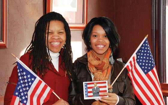 Pamela Bush (left) and her daughter, Latoya, watched the 44th president's inauguration at Cactus Club with other 250...