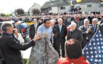 Muhammad Ali (center) unveils a monument on Sept. 1, in Ennis Ireland,...