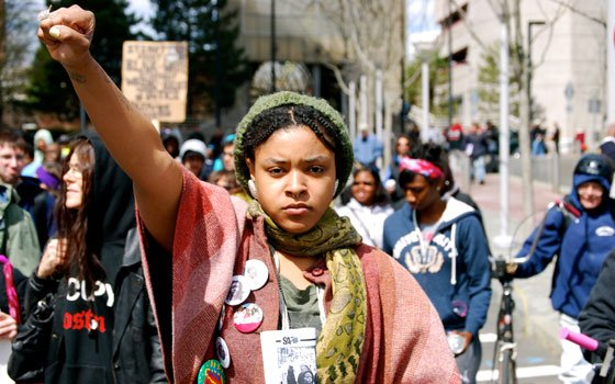 Hundreds of Boston area residents rallied and marched on Saturday, April 7, from Ruggles Station to...