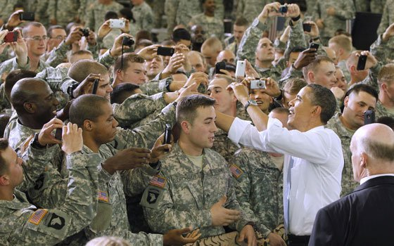 President Barack Obama greets military personnel who recently returned from Afghanistan, Friday, May 6, 2011, at Fort Campbell, Ky....