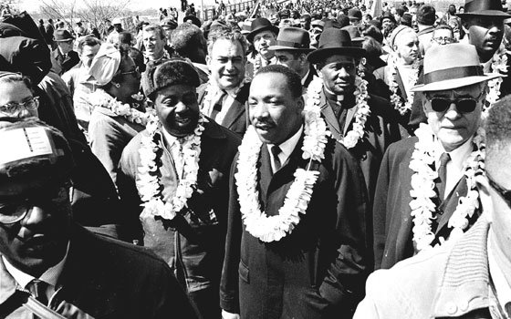 In this March 21, 1965 file photo, Martin Luther King Jr. and his civil rights marchers cross the...