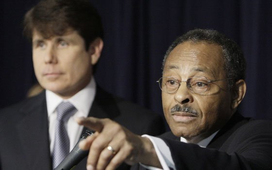 Former Illinois Attorney General Roland Burris (right) speaks as former Illinois Gov. Rod Blagojevich looks on during a...