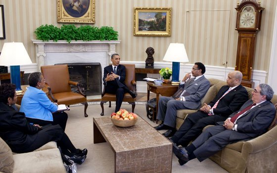 President Barack Obama meets with the Congressional Black Caucus Executive Committee in the Oval Office March 30, 2011....