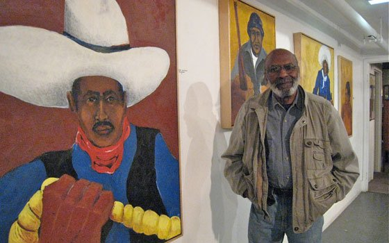 "Artist Hank Kearsley with part of his ""Black West"" series. Kearsley has researched the lives of ex-slaves and..."