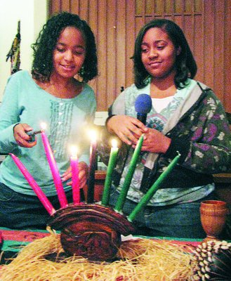 """Kwanzaa, Swahili for """"first fruits,"""" is a seven-day cultural celebration created in 1966 by Dr. Maulana Karenga."""