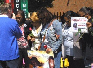 Several mothers gathered Sunday at a memorial wall outside of St. Sabina Catholic church in...