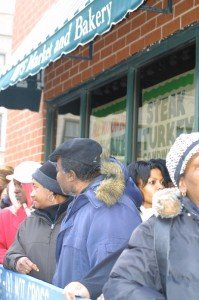 The line for a free meal wrapped around the building of BJs Market & Bakery...