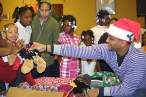 Youth at the non-profit K.L.E.O. Family Life Center received toys, games, stuffed animals and winter...
