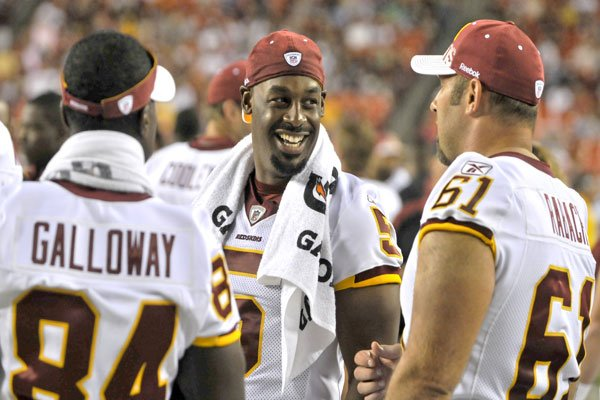 Redskins # 84 Joey Galloway WR and #61Casey Rabach C with Donovan McNabb #5 Photo By John E.DeFreitas.