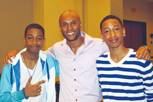 Singer Kenny Lattimore is all smiles with two of the young men he mentors. They were all on hand at this year's UNCF Empower Me Summit. / Photo by Shantella Y. Sherman