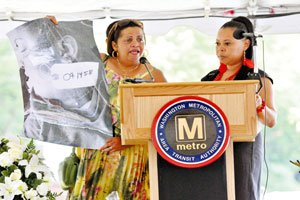 "Carolyn Jenkins, left, displays a picture of her daughter, the late Veronica Dubose, with Twanda Brown, the mother of LaVonda ""Nikki"" King, by her side during the second anniversary memorial service for the victims of Metro's deadliest train accident on June 22 at the Fort Totten Metro Station in Northeast. Despite the tragedy, area riders continue to support the ailing transit system. / Photo by Khalid Naji-Allah"