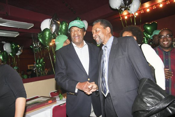 Frank Smith congratulates Marion Barry on his campaign victory at Barry's watch party held at...