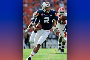 2010 Heisman Trophy winner, Cam Newton, shown here in an earlier game this year, threw for 2 touchdown passes in Auburn's 22-19 win over Oregon in the BCS title game. The Auburn Tigers won their first National Championship in over 50 years.Photo courtesy of Todd Van Emst, Auburn University