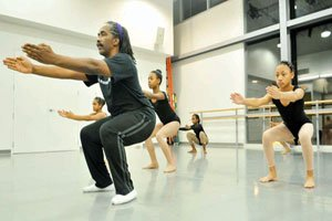 """Dance Institute of Washington instructor Ralph Glenmore, foreground, rehearses with students for the upcoming holiday performance of '""""The Magic Kente Cloth"""" at the Dance Institute of Washington on Thu., Dec. 3 in Northwest.  Photo by Khalid Naji-Allah"""