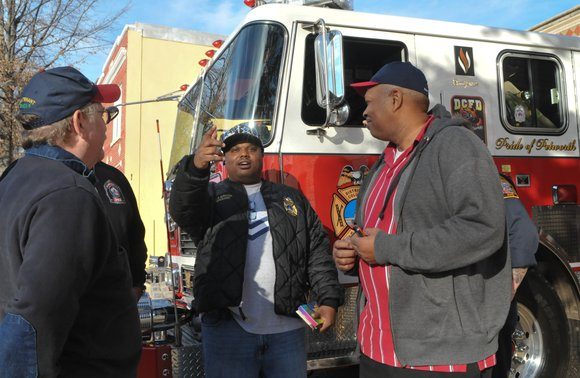 D.C. Fire and EMS Sgt. Baylor (center) talks with firefighter Clarence Rucker, right and retired...