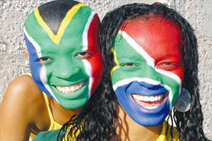 Two young soccer fans enjoying World Cup festivities, and FIFA Logo for South Africa World Cup 2010, the first to take place on the continent. / Courtesy photos