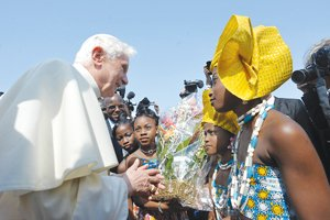 COTONOU, Benin (AP) -- Women wearing dresses bearing Pope Benedict XVI's portrait tried to climb...