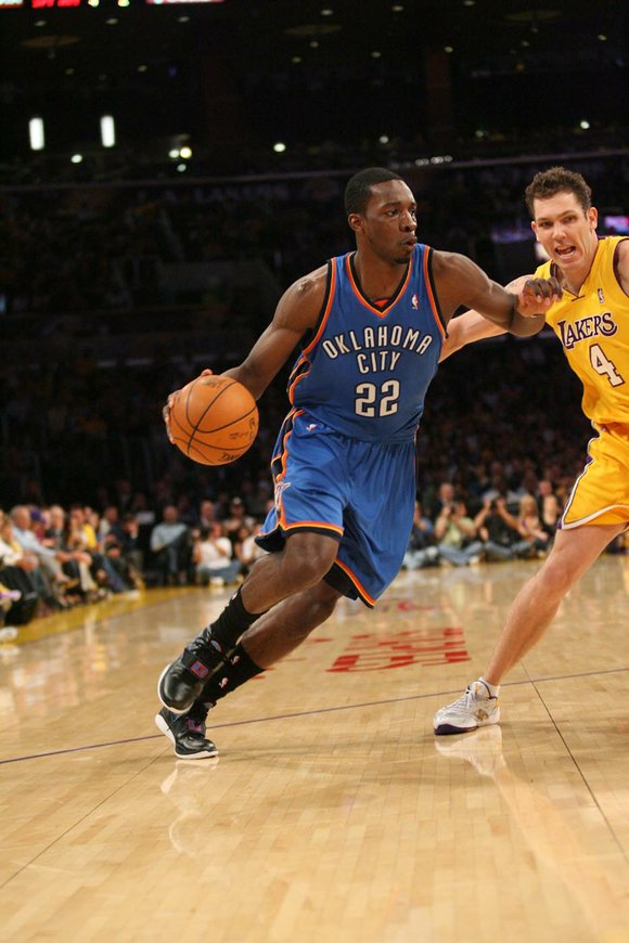 Oklahoma City Thunder guard Jeff Green is guarded by L.A. Laker guard Luke...