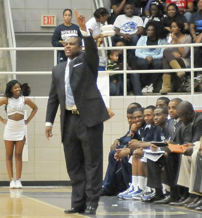 "Kevin Nickelberry was recently named head coach of the Howard University men's basketball team. The new coach, recruited from Hampton University, responded to questions about Howard's loss to North Carolina on Sat., Jan. 15.  ""When your leading scorer gets two fouls in the first five minutes, it changes your game plan. We asked some guys to step up and do things that they were not comfortable doing,"" he said.  Photo by John E. DeFreitas"