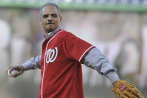 U.S. Attorney General Eric Holder throws the ceremonial first pitch during The Nationals' pre-game celebration of Black Heritage Night Fri., July 2 at Nationals Park in Southeast. Photo by John E. DeFreitas