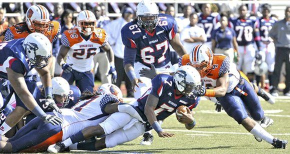 Howard University quarterback Greg McGhee is tackled in the second half of Mid-Eastern Athletic Conference...