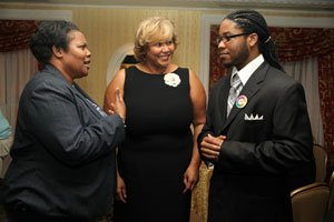 Christopher Stevens, 21 (right), speaks with D.C. Public Schools chancellor Kaya Henderson (left) and Ward 7 Councilmember Yvette Alexander (middle) at the Life Pieces to Masterpieces Strong Man awards gala held at the Willard Hotel in Northwest on Thurs., Oct. 6, 2011.//Photo by Shevry Lassiter