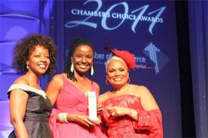 B. Smith (center) is honored by D.C. Chamber of Commerce President Barbara Lang and FedEx Senior Vice President Gina Adams. Photo by Shevry Lassiter