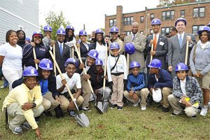Students from the Academy of Construction and Design at Cardozo Senior High School are joined by State Board of Education member Sekou Biddle (standing, 3rd from right) and District Councilmembers Kwame Brown, Muriel Bowser, Harry Thomas, Michael Brown, and David Catania at the recent groundbreaking ceremony for the Academy's first student-built house. Photo by Kea Taylor for Imagine Photography