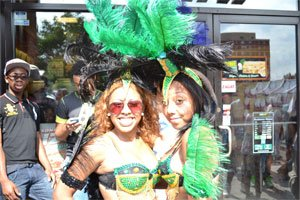 Two Caribbean Festival attendees show off their colorful attire. (Photo by Carlos Hernandez)