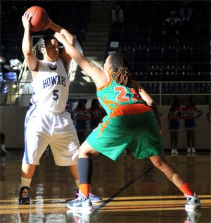 Howard University guard Cheyen Curley-Payne (#5) tries to get past Florida A&M forward Antonia Bennett during the first half of MEAC basketball action at Burr Gymnasium on Sat. Feb.,19. Curley-Payne scored 18 points and Bennett scored 19 points. Photo by John E De Freitas.