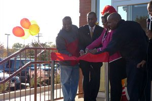County Executive Rushern L. Baker, III (left), McDonald's franchisee Isaac Green (center) and District 7 Council Member, Karen R. Toles (right) cut the ribbon during Isaac and Susan Green's grand opening celebration.