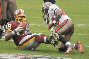 Torain rumbles for 172 yards in front of 66,000 rain soaked fans, but the Redskins'...