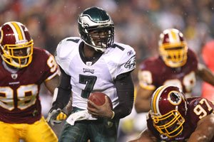 LANDOVER, Md. (AP) -- On the very first play of the game, Michael Vick threw...