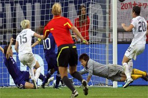 Japan and USA players fight to get the ball under the watchful eyes of German...