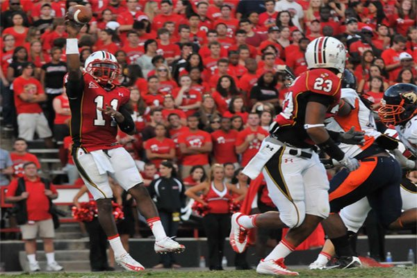 Maryland's QB Jamarr Robinson , left, throws a pass to his receiver during the Morgan State game on Sept. 11. Maryland steamed rolled Morgan 62-3 Khalid Naji-Allah