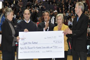 Monumental Sports & Entertainment Founder and Chairman Ted Leonsis (center) joined Mrs. Irene Pollin (2nd right) and her sons Robert (far right) and Jimmy (2nd left) to present the check that represents donations received from Wizards fans since Mr. Pollin's death on November 23, 2009.  Photo by John E De Freitas