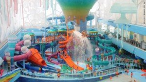 As you speed along the ship's top-deck raft ride, waves break at the ocean's surface 150 feet below. It's an ...