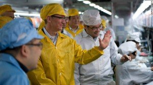 "[caption id=""attachment_71938"" align=""alignnone"" width=""300"" caption=""Apple CEO Tim Cook tours a Foxconn plant in Zhengzhou, China in March. ""]"