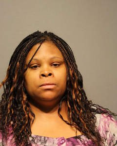The chief financial officer of the Housing Authority of Joliet was taken into custody Tuesday after a warrant was issued ...
