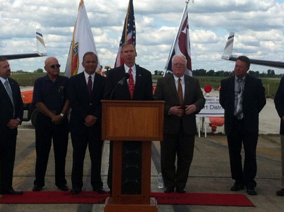 U.S. Rep. Dan Lipinski (IL-3) along with Will County Executive Larry Walsh, Romeoville Mayor John Noak, and other village and ...