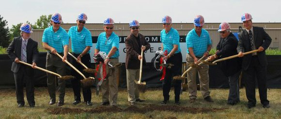 Romeoville Mayor John Noak and staff from G.E. Booth Company, Inc. gathered recently to break ground at the future site ...