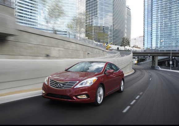 The 2013 Hyundai Azera is one of those 'Oh, my goodness' kind of cars. After a week-long test drive the ...