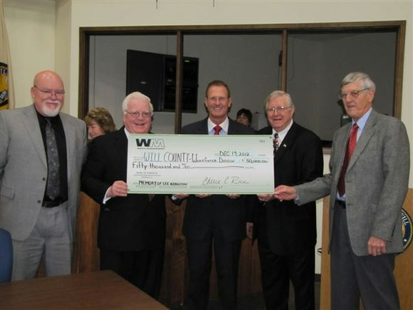 Waste Management of Illinois recently presented a $50,000 check to fund the newly created Lee Addleman/Will County Veterans' Employment Advocacy ...