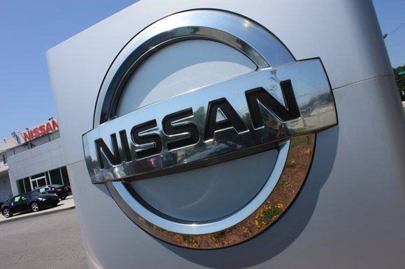 Nissan has suspended production of cars for its home market over problems with its vehicle inspections.