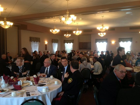 A banquet room filled with about 200 people, including local, state and county officials as well as area business owners ...