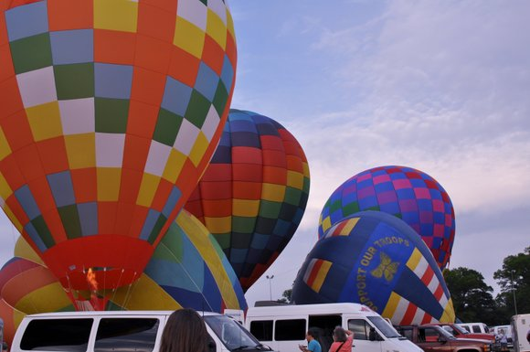 A hot air balloon that crashed and killed three people left propane tanks and a fire extinguisher along a 1.75-mile ...