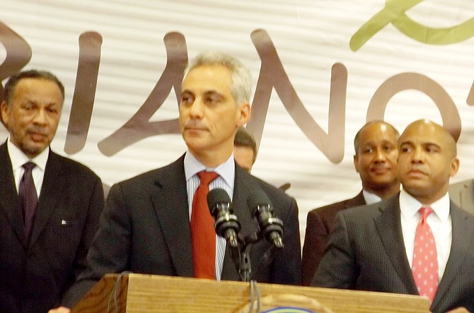 (L-R) Philip Johnson, principal with Johnson & Lee, Ltd., Chicago Mayor Rahm Emanuel, John Bonds, Safeway Construction (pictured in foreground) and 4th Ward Ald. Will Burns (standing next to Mayor Emanuel), got together last Wednesday to announce a new Mariano's grocery store will be built on vacant Chicago Housing Authority land at 39th and King Dr. with construction to start next year.