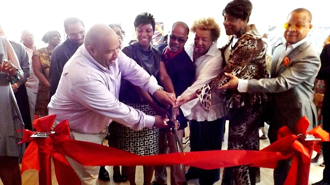 Artists Frances and Andre Guichard, pictured center, take part in the ribbon cutting ceremony of their newly opened, Gallery Guichard on 47th Street in Chicago, and are joined by Dr. Carol Adams, president and CEO of the DuSable Museum; Third Ward Ald. Pat Dowell and Ill. Sen.,. Ken Dukin (D-5th).