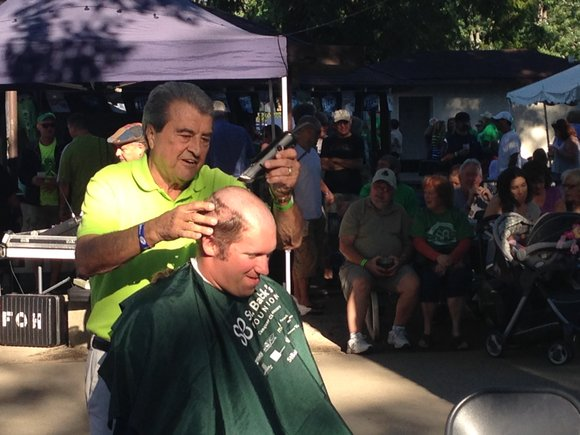Joliet Mayor Tom Giarrante helped volunteers to lose their hair to raise money for the St. Baldrick's Foundation